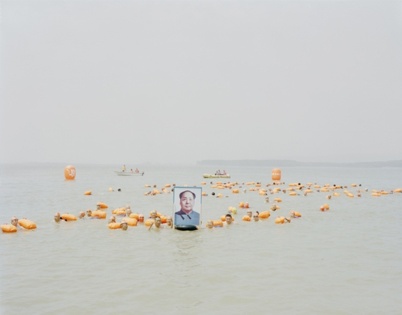 People holding a picture of Mao Zedong across the Yellow River, Henan, 2012